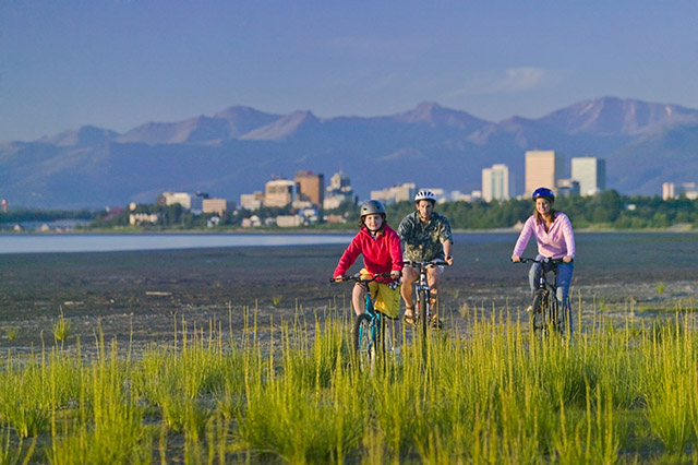 Family on a bike coastal trail Anchorage Your getaway to alaska
